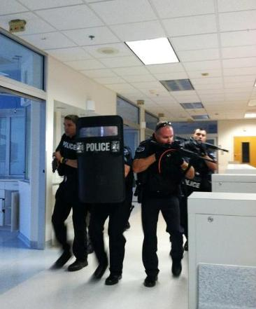 Officers training at Cherry Creek mall with shields