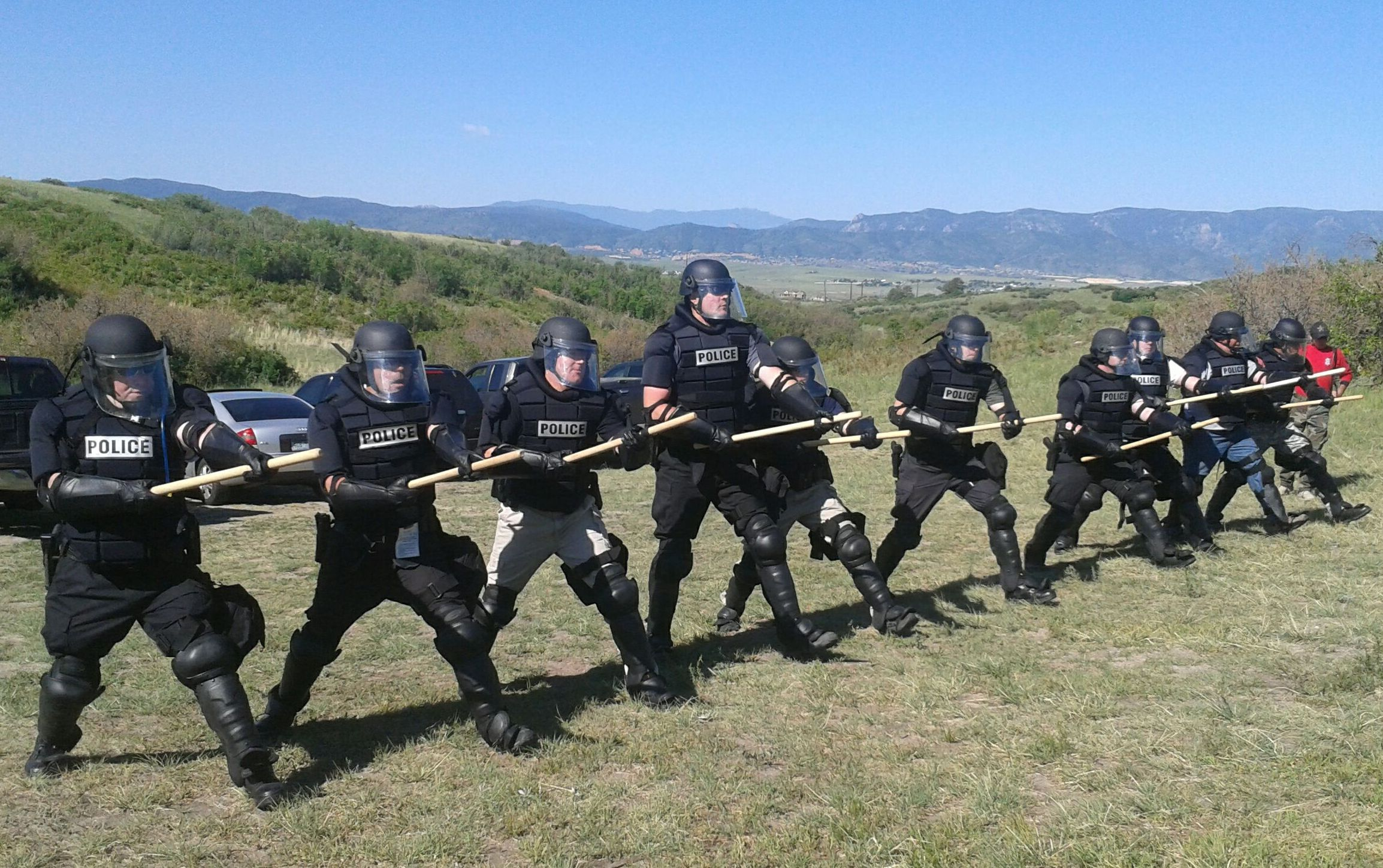 training for riot control with officers in line formation